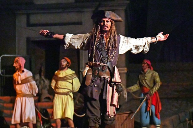 EXCLUSIVE: Johnny Depp stunned fans on the Pirates of the Caribbean ride at Disneyland last night (wed) - by making a surprise appearance dressed as Captain Jack Sparrow. The legendary actor wore his trademark Pirate outfit as he shocked delighted theme p